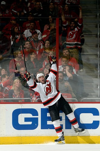 Andy Greene #6 of the New Jersey Devils celebrates after scoring the game winning goal in overtime during an NHL game against the Washington Capitals at Verizon Center on December 21, 2013 in Washington, DC. (Photo by Patrick McDermott/NHLI via Getty Images)