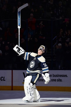 COLUMBUS, OH - JANUARY 10: Goaltender Sergei Bobrovsky #72 of the Columbus Blue Jackets waves to the fans after getting first-star of the game for his shutout against the Carolina Hurricanes on January 10, 2014 at Nationwide Arena in Columbus, Ohio. (Photo by Jamie Sabau/NHLI via Getty Images)