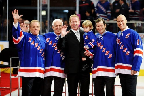 8e0b1a710 Former New York Ranger Brian Leetch holds his son Sean and stands with  former players (L-R) Rod Gilbert