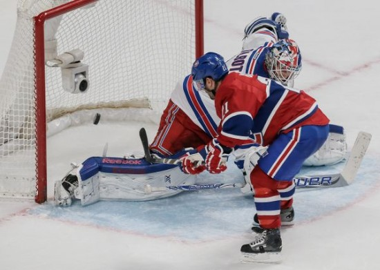 Canadiens captain Brian Gionta scores the game-winning penalty goal against New York Rangers goalie Cam Talbot during overtime in Montreal on Saturday. (Photo by Dario Ayala, The Gazette)