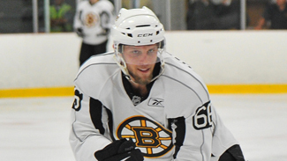 Photo of Boston Bruins prospect Colton Hargrove chases a signing in his final years of NCAA hockey