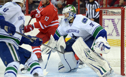 Eddie Lack went from the Pacific Northwest to the Raleigh, North Carolina this summer. (canucks.nhl.com)